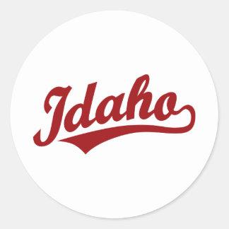 Idaho script logo in red classic round sticker