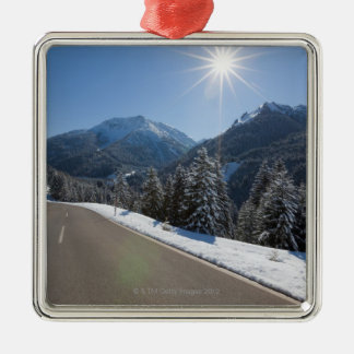Idyllic empty road thrugh a winter landscape, 2 christmas ornament