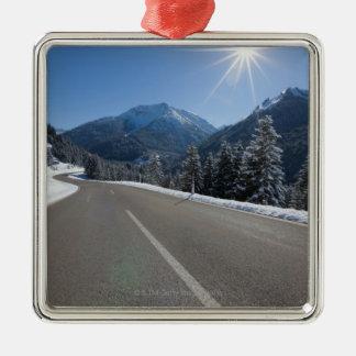 Idyllic empty road thrugh a winter landscape, christmas ornament