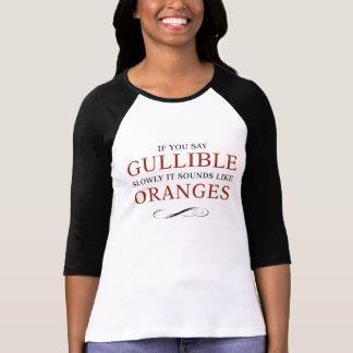If you say Gullible slowly, it sounds like Oranges Tshirt