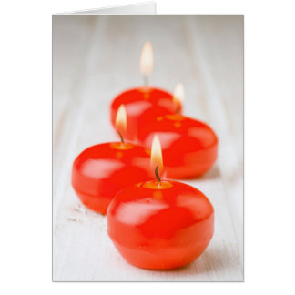Ignited and aligned red candles card