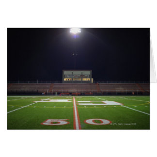 Illuminated American football field at night Card