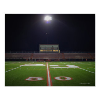 Illuminated American football field at night Poster