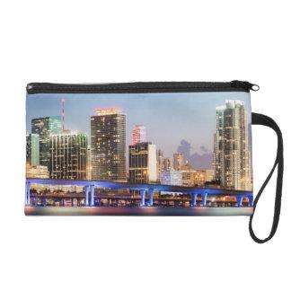 Illuminated skyline of downtown Miami at dusk Wristlet Purses