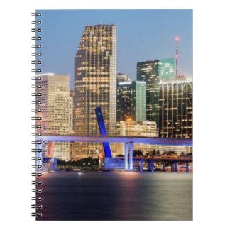 Illuminated skyline of downtown Miami at dusk Notebook