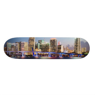 Illuminated skyline of downtown Miami at dusk Skateboards