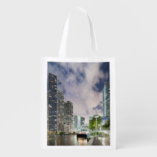 Illuminated towers at the Miami River waterfront Reusable Grocery Bag