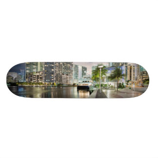 Illuminated towers at the Miami River waterfront Skateboard Deck