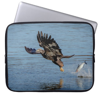 Immature Bald Eagle dropping a fish Laptop Computer Sleeves