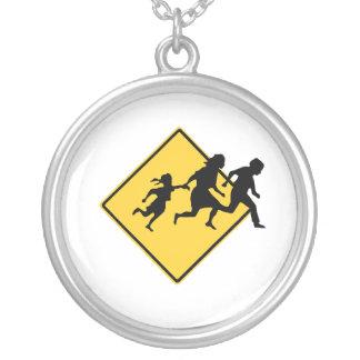 Immigrant crossing round pendant necklace