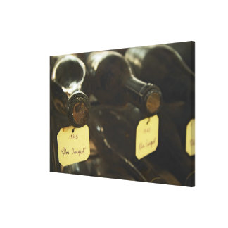In the underground wine cellar: lying bottles in canvas print