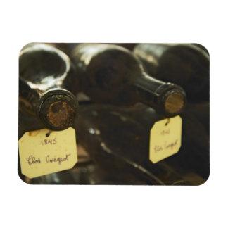 In the underground wine cellar: lying bottles in vinyl magnet