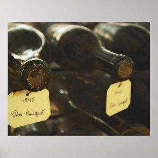 In the underground wine cellar: lying bottles in poster