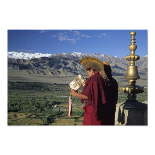 India, Ladakh, Thikse. Buddhist monk blows Art Photo