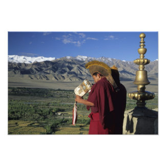 India, Ladakh, Thikse. Buddhist monk blows Photographic Print