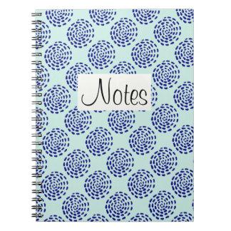 Indigo dark blue striped circle pattern on blue notebook