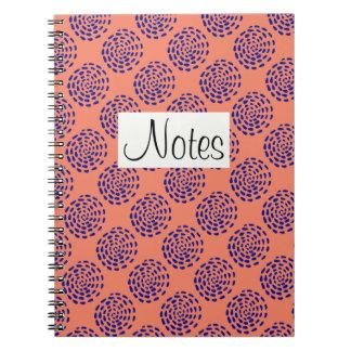 Indigo dark blue striped circle pattern on salmon spiral notebooks