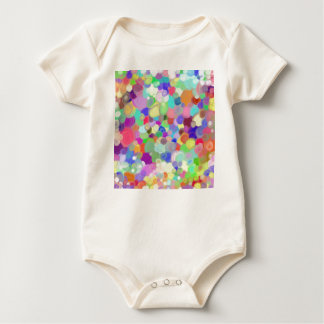 Infant with tempera paints baby bodysuit