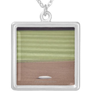 Infield, second base, outfield, and 333 foot silver plated necklace