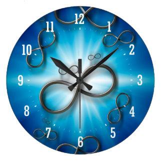 Infinity on illuminated blue background Wall Clock