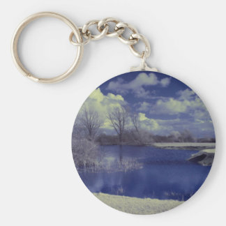 Infrared landscape in blue with lake keychain