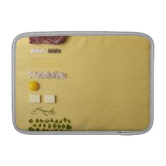 Ingredients for steak tartare on yellow MacBook sleeve
