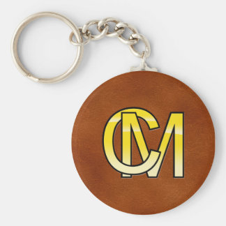 initial C and M out of gold Basic Round Button Key Ring