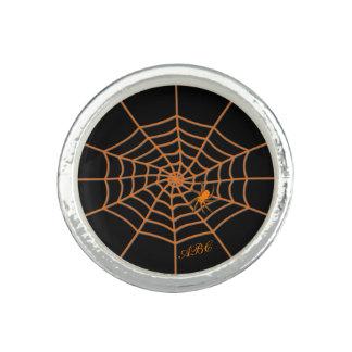 Initials spider on orange web ring