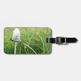 Ink cap mushroom in field luggage tag
