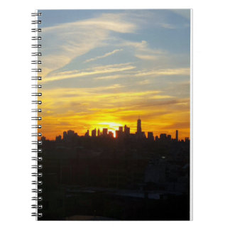 Inspiring sunset over city notebook