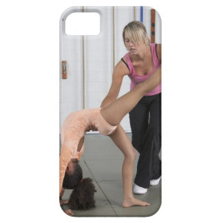 instructor helping girl with her floor exercises iPhone 5 case
