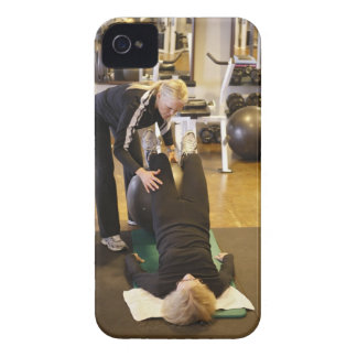 Instructor helps senior client with stretches iPhone 4 Case-Mate cases