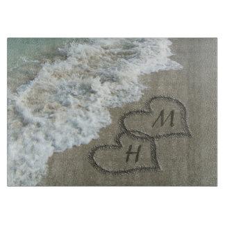 Interlocking Hearts on Beach Sand Cutting Board