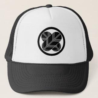 Intersecting hawk feathers with foot in circle trucker hat