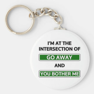 "Intersection of ""go away"" and ""you bother me"" basic round button key ring"