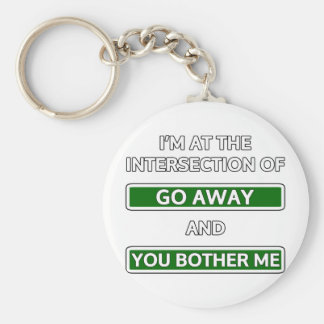 """Intersection of """"go away"""" and """"you bother me"""" keychains"""