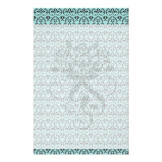 intricate black damask pattern on pretty blue stationery design