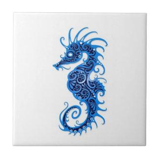 Intricate Blue Seahorse Design on White Tile