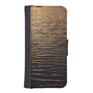 iPhone: Ripples on a Water Surface During Sunset
