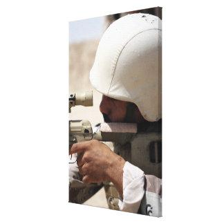 Iraqi Army Sergeant sights in down range Canvas Print
