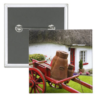 Ireland, Adare. Metal containers on cart and 15 Cm Square Badge