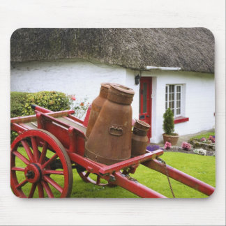Ireland, Adare. Metal containers on cart and Mouse Mat