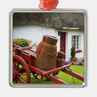 Ireland, Adare. Metal containers on cart and Silver-Colored Square Decoration