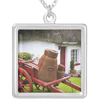 Ireland, Adare. Metal containers on cart and Silver Plated Necklace