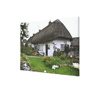 Ireland, Adare. Thatched-roof cottage Canvas Print