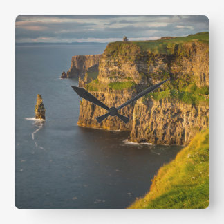 Ireland coastline at sunset square wall clock