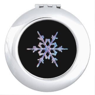 Iridescent snowflake travel mirrors
