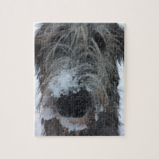 irish wolfhound playing in the snow jigsaw puzzle