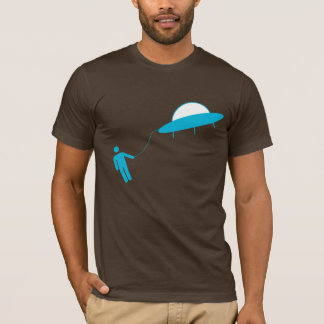 Is he hitching a ride or being abducted by aliens? T-Shirt