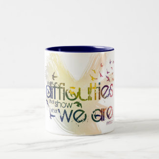 it is difficulties that show what we are. Two-Tone mug